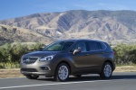 Picture of a driving 2017 Buick Envision AWD in Bronze Alloy Metallic from a front left three-quarter perspective