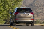 Picture of a driving 2017 Buick Envision AWD in Bronze Alloy Metallic from a rear perspective