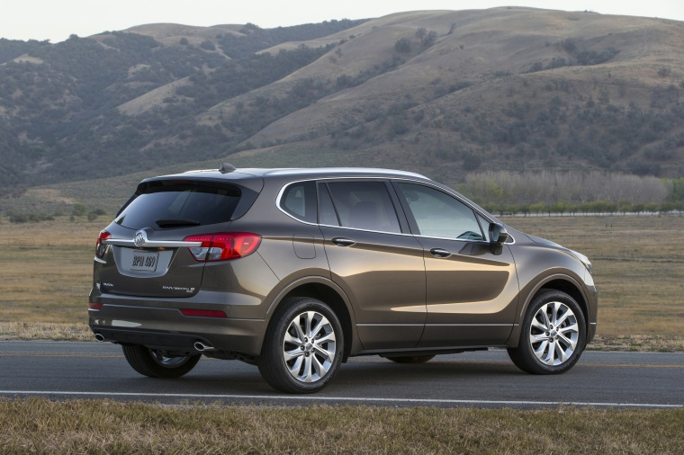 2018 Buick Envision AWD in Bronze Alloy Metallic from a rear right three-quarter view