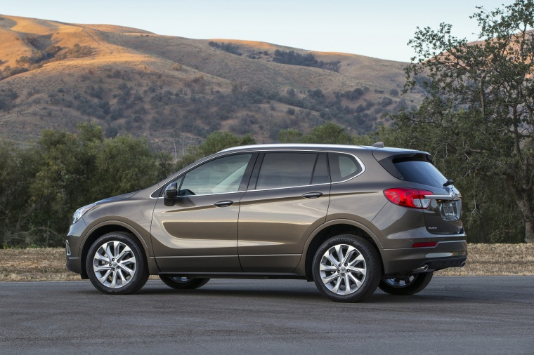 2018 Buick Envision AWD in Bronze Alloy Metallic from a rear left three-quarter view