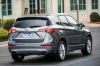Picture of a driving 2019 Buick Envision AWD in Satin Steel Metallic from a rear right perspective