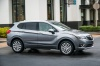 Picture of a driving 2019 Buick Envision AWD in Satin Steel Metallic from a front right three-quarter perspective