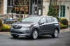 Picture of a driving 2019 Buick Envision AWD in Satin Steel Metallic from a front left perspective