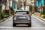 Picture of a driving 2019 Buick Envision AWD in Satin Steel Metallic from a rear perspective