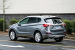 Picture of a driving 2019 Buick Envision AWD in Satin Steel Metallic from a rear left three-quarter perspective
