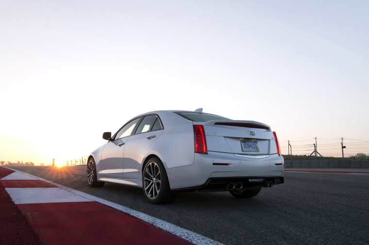 Driving 2018 Cadillac ATS-V Sedan in Crystal White Tricoat from a rear left view