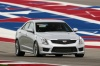Driving 2018 Cadillac ATS-V Sedan in Crystal White Tricoat from a front right view