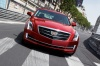 Driving 2018 Cadillac ATS Sedan 2.0T in Red Obsession Tintcoat from a frontal view