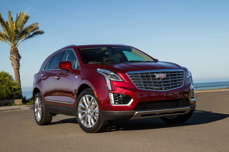 2018 Cadillac XT5 AWD in Red Passion Tintcoat from a front right view