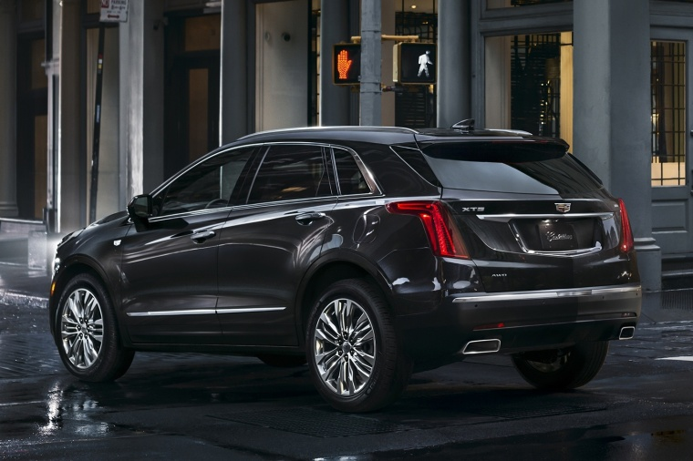 2018 Cadillac XT5 AWD in Dark Granite Metallic from a rear left three-quarter view