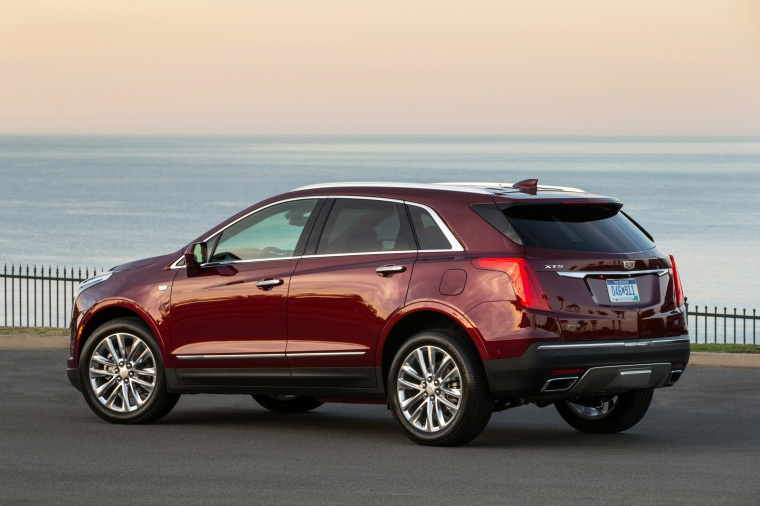 2018 Cadillac XT5 AWD in Red Passion Tintcoat from a rear left three-quarter view
