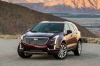 2018 Cadillac XT5 AWD in Red Passion Tintcoat from a front left view
