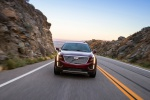 Picture of a driving 2019 Cadillac XT5 AWD in Red from a frontal perspective