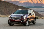 Picture of a 2019 Cadillac XT5 AWD in Red from a front left perspective