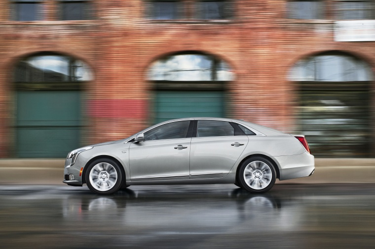 Driving 2018 Cadillac XTS in Radiant Silver Metallic from a side view