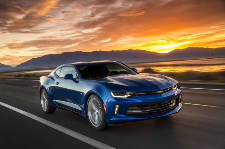 Driving 2017 Chevrolet Camaro RS Coupe in Hyper Blue Metallic from a front right view