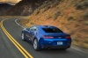 Driving 2017 Chevrolet Camaro RS Coupe in Hyper Blue Metallic from a rear left view