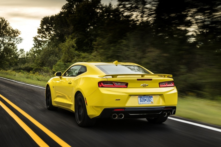 Driving 2018 Chevrolet Camaro SS Coupe in Bright Yellow from a rear left view
