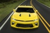 Driving 2018 Chevrolet Camaro SS Coupe in Bright Yellow from a frontal view