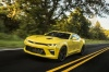 Driving 2018 Chevrolet Camaro SS Coupe in Bright Yellow from a front left three-quarter view