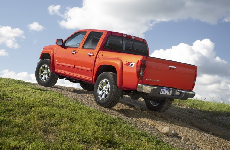 2010 Chevrolet Colorado Crew Cab LT V8 Z71 in Tangier Orange from a rear left three-quarter view
