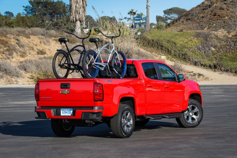 2015 Chevrolet Colorado Crew Cab in Red Hot from a rear right three-quarter view