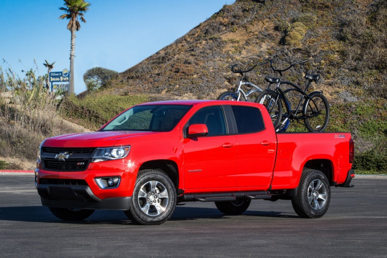 2015 Chevrolet Colorado Crew Cab in Red Hot from a front left three-quarter view