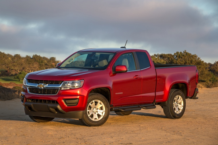 2015 Chevrolet Colorado Extended Cab in Red Rock Metallic from a front left three-quarter view
