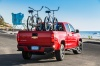 2015 Chevrolet Colorado Crew Cab in Red Hot from a rear right view