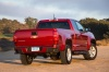 2015 Chevrolet Colorado Extended Cab in Red Rock Metallic from a rear right view