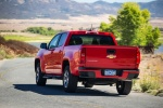 2015 Chevrolet Colorado Crew Cab in Red Hot - Driving Rear Left View