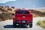 2015 Chevrolet Colorado Crew Cab in Red Hot - Driving Rear View