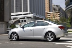 2013 Chevrolet Cruze LT in Silver Ice Metallic - Driving Rear Left Three-quarter View