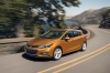 Driving 2017 Chevrolet Cruze Premier RS Hatchback in Orange Burst Metallic from a front left view