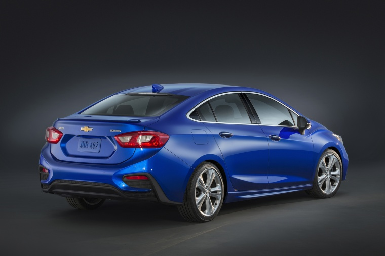 2018 Chevrolet Cruze Premier Sedan in Kinetic Blue Metallic from a rear right three-quarter view