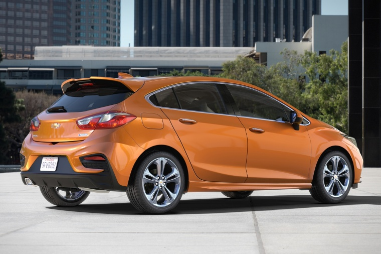 2018 Chevrolet Cruze Premier RS Hatchback in Orange Burst Metallic from a rear right three-quarter view