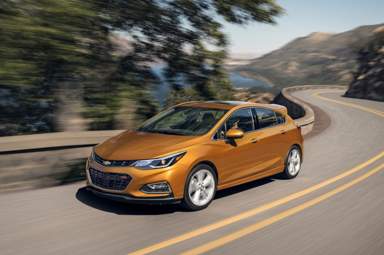 Driving 2018 Chevrolet Cruze Premier RS Hatchback in Orange Burst Metallic from a front left view