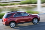 Picture of a driving 2014 Chevrolet Equinox LTZ in Crystal Red Tintcoat from a rear right three-quarter top perspective
