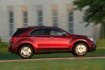 Picture of a driving 2014 Chevrolet Equinox LTZ in Crystal Red Tintcoat from a right side perspective