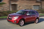 Picture of a driving 2014 Chevrolet Equinox LTZ in Crystal Red Tintcoat from a front left perspective