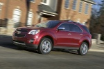 Picture of a driving 2014 Chevrolet Equinox LTZ in Crystal Red Tintcoat from a front left three-quarter perspective