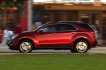 Picture of a driving 2014 Chevrolet Equinox LTZ in Crystal Red Tintcoat from a left side perspective