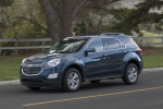 Picture of a driving 2017 Chevrolet Equinox LT in Blue Velvet Metallic from a front left three-quarter perspective