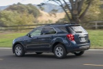 Picture of a driving 2017 Chevrolet Equinox LT in Blue Velvet Metallic from a rear left three-quarter perspective