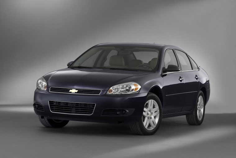 2012 Chevrolet Impala LTZ in Imperial Blue Metallic from a front left view