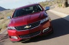 Driving 2018 Chevrolet Impala Premier in Cajun Red Tintcoat from a frontal view