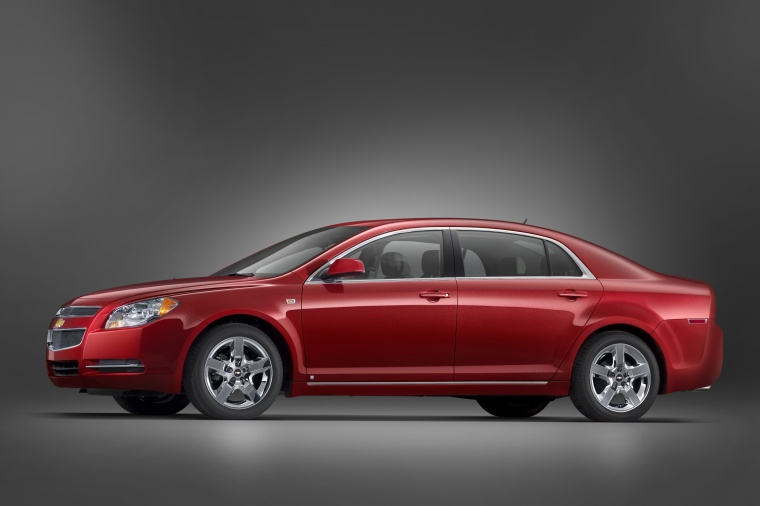 2010 Chevrolet Malibu LT in Red Jewel Tintcoat from a side view