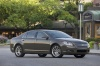 2010 Chevrolet Malibu LTZ in Taupe Gray Metallic from a front right three-quarter view