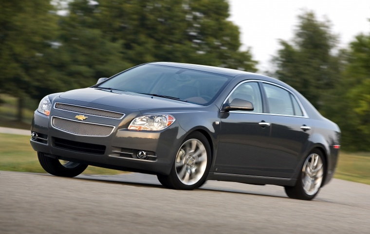 2012 chevrolet malibu ltz in taupe gray metallic color driving front left three quarter view. Black Bedroom Furniture Sets. Home Design Ideas