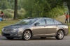 2012 Chevrolet Malibu LTZ in Taupe Gray Metallic from a front left three-quarter view